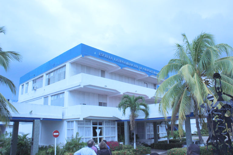 Blue and white building of the Latin American School of Medicine in Cuba.